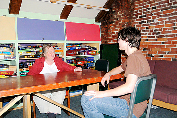 The Game Loft Executive Director Patricia Estabrook (left) discusses 1968 project with participant Patrick Howard.  PHOTO COURTESY OF THE GAME LOFT