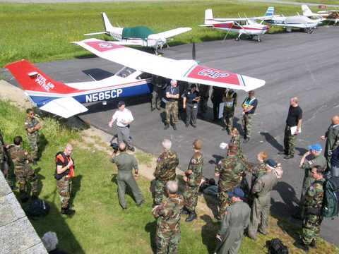 Col. Dan Leclair (white shirt), wing commander for the Maine Civil Air Patrol, discusses the mission Saturday during a search and rescue exercise in Machias.  Photo courtesy of James Sparage