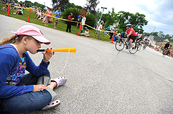Sydney Jordan, 8 of Poland, ME blows on her noisemaker as cyclists approach the Belfast finish of the 26th Annual Trek Across Maine for the American Lung Association. She was camped out at the finish line Sunday morning as she waited for her father Damon Jordan and a friend to finish their ride. The three-day , 180-mile bike ride started Friday from Sunday River and ended Sunday in Belfast .  BANGOR DAILY NEWS PHOTO BY JOHN CLARKE RUSS