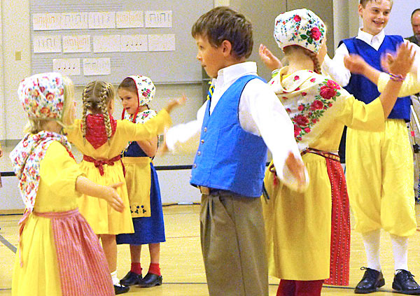 Members of the New Sweden Little Folk Dancers perform for a crowd of approximately 70 people during the 140th annual Midsommer Festival on Sunday. The traditional fete marks the end of winter and the beginning of summer. A host of events are held in New Sweden and surrounding communities to celebrate the longest day of the year. BANGOR DAILY NEWS PHOTO BY JEN LYNDS