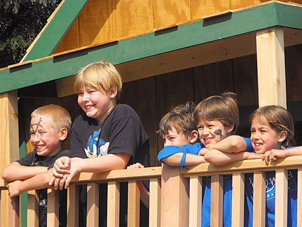 Leif Dahlk of Littleton (second from right, in blue shirt,) poses with some friends on the porch of his new playhouse in the back yard of his home on the Hill Siding Road. Dahlk, an 8-year-old cancer survivor, saw his wish for a club house come true on Saturday thanks to the Make-A-Wish Foundation of Maine, the Betty Crocker Stirring Up Wishes program and a number of volunteers. BANGOR DAILY NEWS PHOTO BY JEN LYNDS