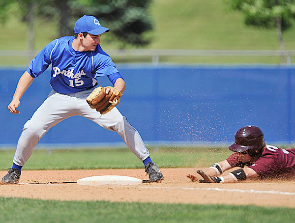 Central Aroostook's third baseman  Kasey Brewer, (15), makes the tag for the out on Richnmond's Eric Dowd, (3), in the third inning of their CLass D State Championship game at Mansfield Stadium in Bangor, Saturday, June 19, 2010. BANGOR DAILY NEWS PHOTO BY MICHAEL C. YORK