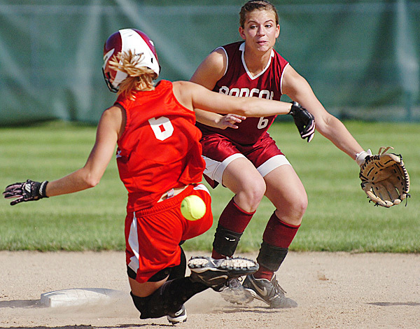South Portland's Danielle DiBiase (left) slides into second as Bangor's Mariah Cassum anticipates the throw in the third inning of their Class A softball championship game at Saint Joseph's College in Standish on Saturday, June 19, 2010. DiBiase was safe on the play and South Portland won 1-0. BANGOR DAILY NEWS PHOTO BY BRIDGET BROWN