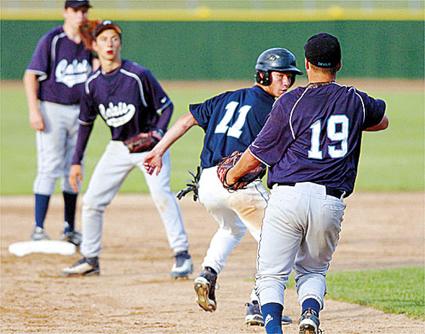 Dirigo's Arik Fenstermacher (11) is caught between Calais' Adam Geel (19), Dylan Carter (back left) and Jeremy Beers (second from left) during a play in the sixth inning of the Class C baseball championship at Saint Joseph's College in Standish on Saturday, June 19, 2010. Fenstermacher was tagged out at third and Dirigo won 4-2. BANGOR DAILY  NEWS PHOTO BY BRIDGET BROWN