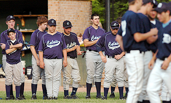 The Calais team watches as Dirigo receives their championship trophy following the Class C baseball game at Saint Joseph's College in Standish on Saturday, June 19, 2010. Dirigo won 4-2. BANGOR DAILY NEWS PHOTO BY BRIDGET BROWN