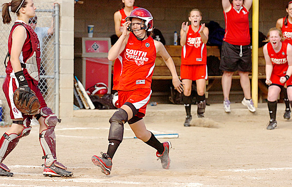 South Portland's Danica Gleason (right) runs towards home plate as Bangor catcher Jeri Cosgrove (left) waits for the throw in the sixth inning of their Class A softball championship game at Saint Joseph's College in Standish on Saturday, June 19, 2010. Gleason scored the only run of the game launching them to their 1-0 victory. BANGOR DAILY NEWS PHOTO BY BRIDGET BROWN
