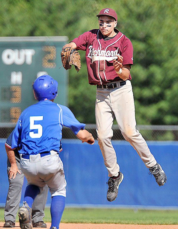 Richmond first baseman Brandon Harris,(18), takes a high throw and makes the tag on Central Aroostook's Dan  Brewer,(5), in the fifth inning of their CLass D State Championship game at Mansfield Stadium in Bangor, Saturday, June 19, 2010. BANGOR DAILY NEWS PHOTO BY MICHAEL C. YORK