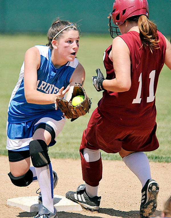Deer Isle-Stonington shortstop Janelle Ciomei, (3), looks for the call at second base on Richmond runner Morgan Rines, (11), in the second  inning of their State Class D Championship game at Brewer, Saturday, June 19, 2010. BANGOR DAILY NEWS PHOTO BY MICHAEL C. YORK
