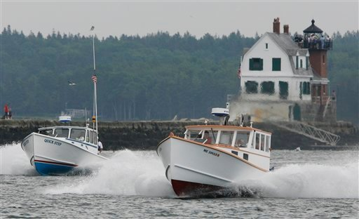 &quotQuick Step&quot left, and &quotEmily Grace,&quot right, head down the race course during a lobster boat race in Rockland, Maine Sunday, June 20, 2010.  In all, more than 110 boats raced over the weekend as Maine's annual lobster boat racing season kicked off. (AP Photo/Joel Page)
