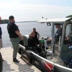 Search for boater at Big Lake to resume today; boy rescued
