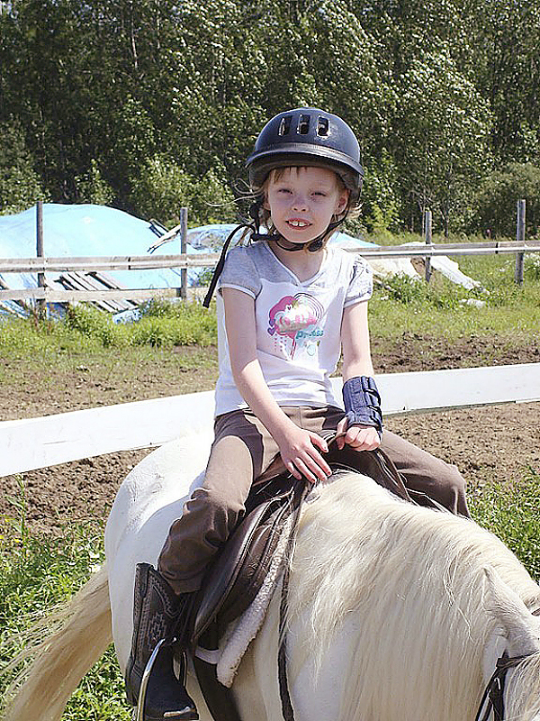 PRESQUE ISLE: Angel Parsons, 8, of Presque Isle, rides a horse last summer as her family looks on. Parsons has mitochondrial disease and her doctors agree that she could benefit from a service dog. Donors and local businesses through the state helped Angel's family raise the $15,000 that they needed to buy the dog to assist her at home and at school. The girl and her grandmother and guardian, Debbie Kinney, will travel to Ohio in September to receive the animal. (PHOTO COURTESY OF DEBBIE KINNEY) Lynds story