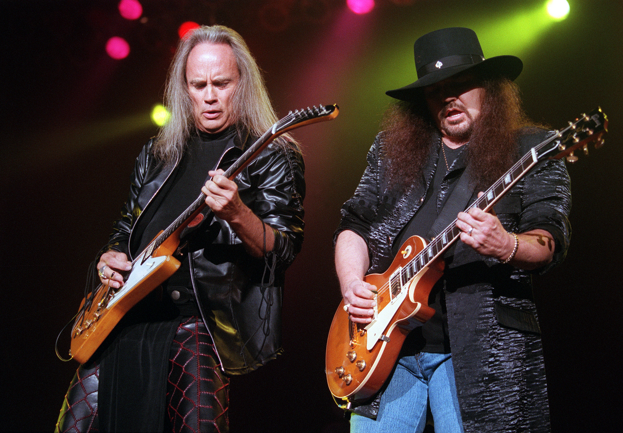 NECK AND NECK  Ricky Medlocke (left) and Gary Rossington of Lynyrd Skynyrd team up on guitar licks during the band?s performance Saturday at the Bangor Auditorium. (NEWS Photo by Miller Pearsall)