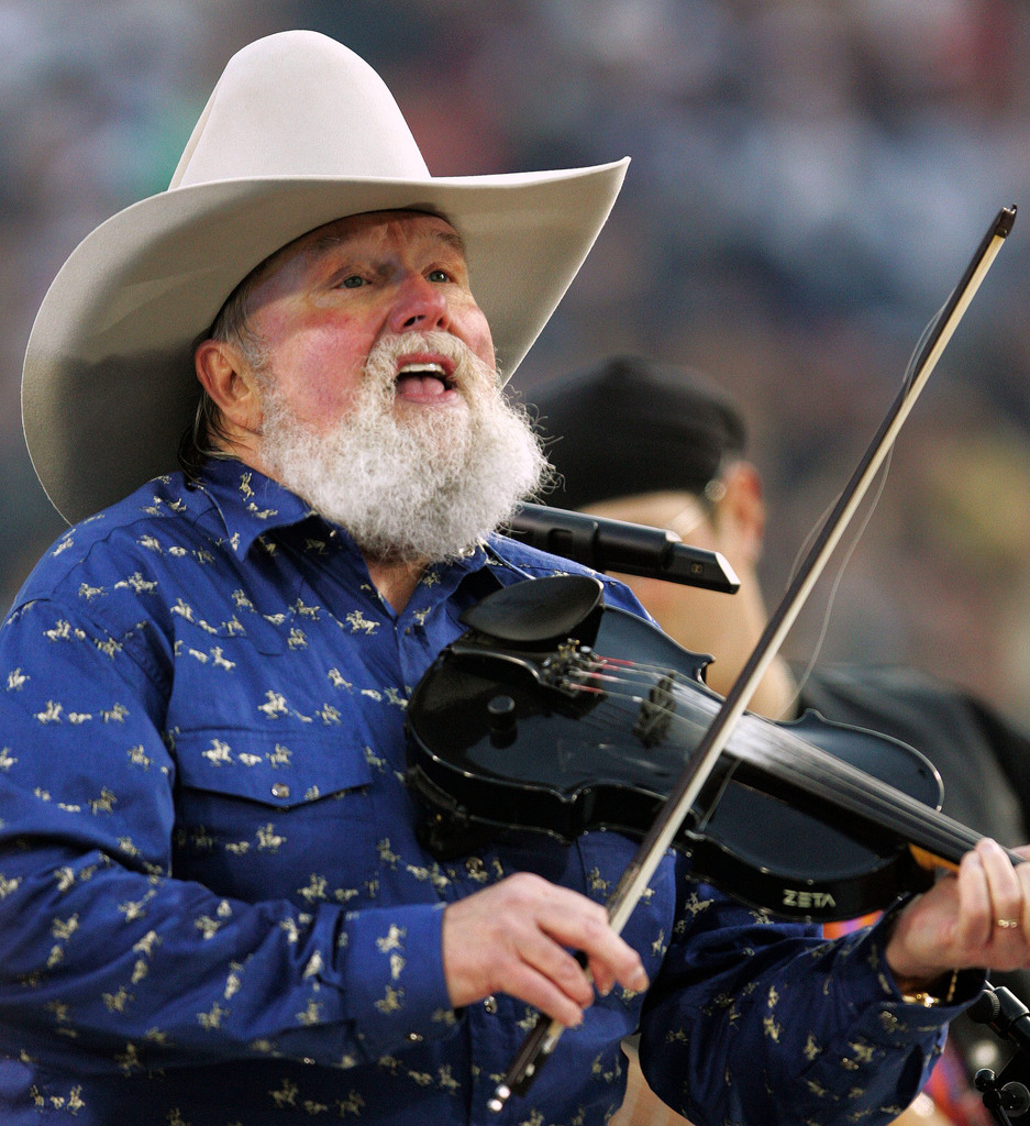 Charlie Daniels performs during pre-game festivities before Super Bowl XXXIX between the New England Patriots and the Philadelphia Eagles at Alltel Stadium on Sunday, Feb. 6, 2005, in Jacksonville, Fla. (AP Photo/David J. Phillip)