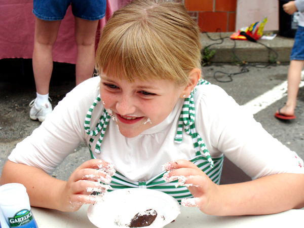 Alyssa Patterson, 8, of Bangor, had all she could do to stomach four whoopie pies to earn second place Saturday in the children's whoopie pie eating festival in Dover-Foxcroft. Patterson is the daughter of Dan and Karen Patterson of Bangor. (Bangor Daily News Photo by Diana Bowley)