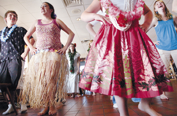 Hampden resident Ericka Garcia, 16, (second from left) enjoys Hawaiian-style dance instruction with friends including Stephen Hoffman, 15, (left) and Sarabeth Miller, 16, (far right) during a luau party put on by the Make-A-Wish Foundation at Dysart's in Hermon on Tuesday, June 22, 2010. The foundation is also granting Garcia's wish--to travel to Hawaii.  Garcia, who suffers from dermatomyositis, and her family leave for the island state next week where she will get a chance to practice her dance skills and taste authentic Hawaiian dishes. (Bangor Daily News/Bridget Brown)