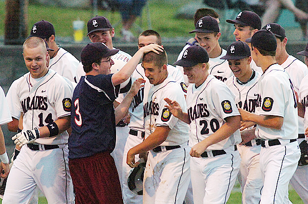 Bangor Commrades #12 Neal Lewis (center) is mobbed by his teammates after batting a homerun during 3rd inning action aginst the Hampden Riverdogs at Hampden on Tuesday, June 22, 2010. (Bangor Daily News/Kevin Bennett)
