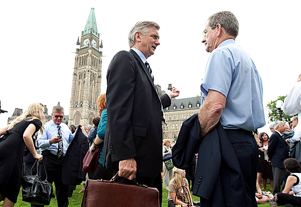 Senators, parliamentarians and their staff are shown after being evacuated from Parliament Buildings following an earthquake in Ottawa, Canada on Wednesday June 23, 2010. A magnitude-5.0 earthquake struck at the Ontario-Quebec border region of Canada on Wednesday, shaking homes and businesses from Toronto to the states of New York and Michigan, according to the U.S. Geological Survey. AP PHOTO/ THE CANADIAN PRESS/ ADRIAN WYLD