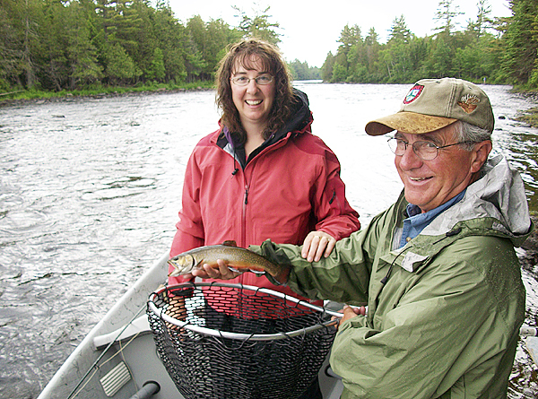 Guide Dan Legere of Greenville holds up the brook trout Tiffany Shepard of Deer Isle caught during Sunday's drift boat trip on the East Outlet of the Kennebec River. Shepard was this year's winner of the BDN drift boat trip, which runs in conjunction witht the Eastern Maine Sportsman's Show.