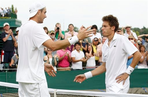 John Isner of the US, left, reaches out to embrace France's Nicolas Mahut, at the end of their epic men's singles match at the All England Lawn Tennis Championships at Wimbledon, Thursday, June 24, 2010. (AP Photo/Suzanne Plunkett, pool)