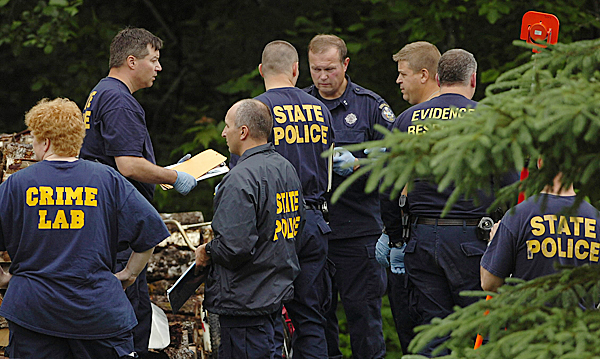 Maine State Police Evidence Response Team members work at the scene of a triple homicide on U.S. Route 1 in Amity on Thursday morning, June 24, 2010 where detectives say two men and a young boy were stabbed to death. Jeffrey Ryan, 55, his son Jesse Ryan, 10, and Jason Dehahn, 30, who was visiting the Ryan residence, were found dead Wednesday night by a relative. BANGOR DAILY NEWS PHOTO BY BRIDGET BROWN