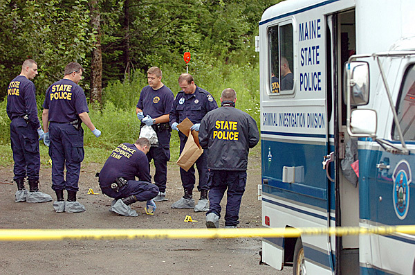 Maine State Police Evidence Response Team members investigate the scene of a triple homicide in Amity on Thursday morning, June 24, 2010, where detectives say two men and a young boy were stabbed to death. BANGOR DAILY NEWS PHOTO BY BRIDGET BROWN