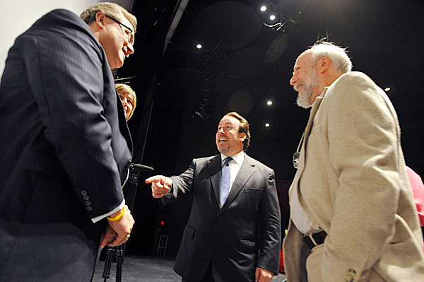 Lucas Richman, center, chats  with  BSO Board President Samuel Lanham, Jr., far left, BSO Search Committee Chair Joyce Clark-Sarnacki (cq) and BSO board member Dr. Stuart Marrs (cq), right, following Thursday's press conference at the Collins Center for the Arts at the University of Maine in Orono. The Bangor Symphony Orchestra announced Richman as its new music director and conductor. BANGOR DAILY NEWS PHOTO BY JOHN CLARKE RUSS