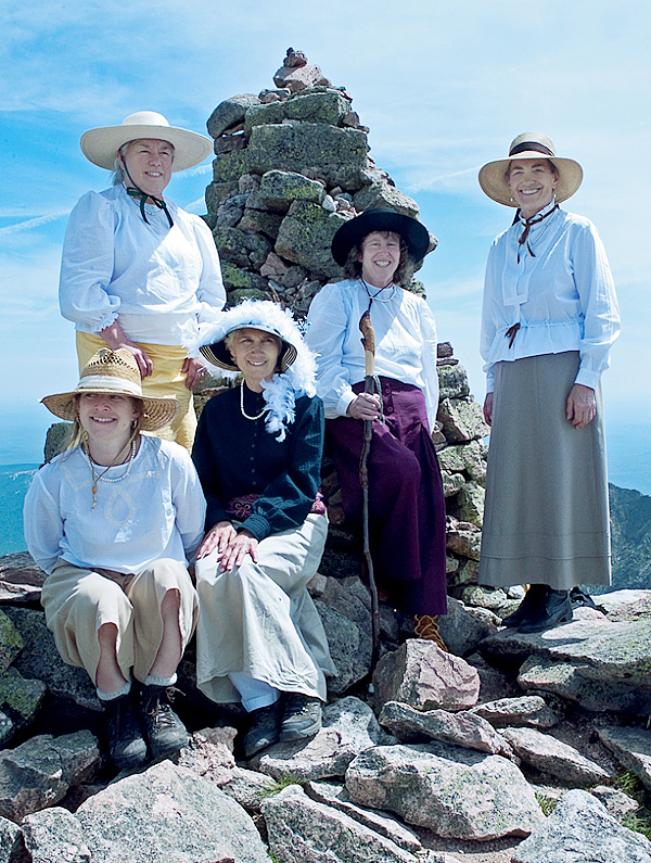 Left to right, Rachael Story, Marsha Donahue, Donna Gordon, Holly Hamilton and Barbara Bentley are all smiles at the summit cairn on Baxter Peak last Tuesday. The five re-enacted how the early women climbers would have climbed the mountain in 1890's clothing. All Photos Courtesy of Bill Bentley.
