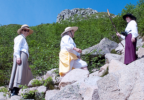 Left to right, Barbara Bentley, Marsha Donahue and Holly Hamilton make the climb up the Saddle on their way to the Baxter Peak, the summit of Katahdin last Tuesday. They were re-enacting the early women climbers on the mountain in 1890's dress. They were joined by Rachael Story and Donna Gordon, not pictured.  All Photos Courtesy of Bill Bentley.