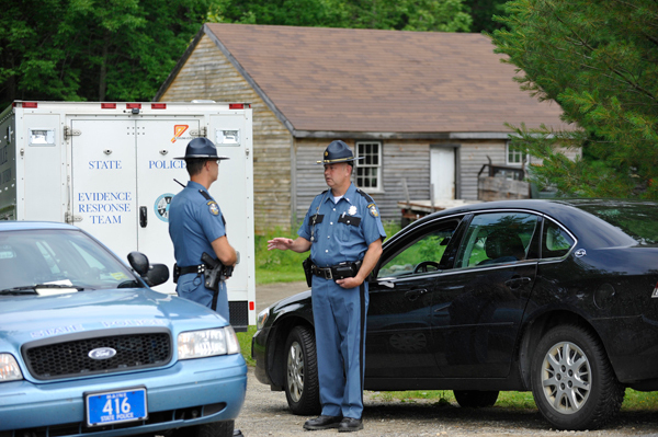 On Saturday morning Maine State Trooper Ryan Brockway, left, of Maine State Police Troop D (Thomaston) and Lt. David Bowler, right,  with Maine State Police headquarters in Augusta converse at the end of a driveway of the residence in Brooks where 49-year-old Deborah Littlefield's body was found Friday night, June 25, 2010. Her 48-year-old husband, Michael Littlefield,  was taken into custody by troopers and deputies. (Bangor Daily News/John Clarke Russ)