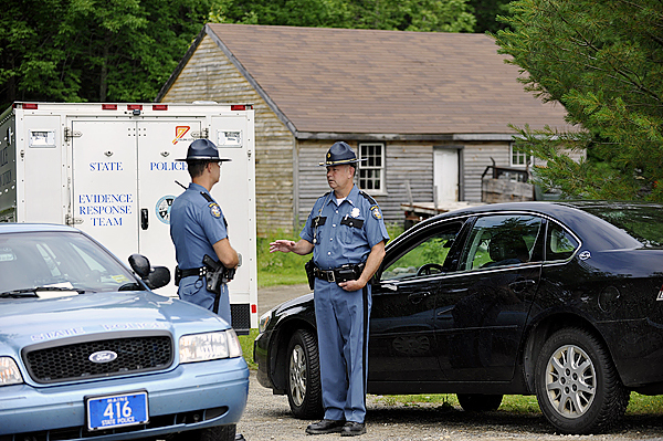 On Saturday morning Maine State Trooper Ryan Brockway, left, of Maine State Police Troop D (Thomaston) and Lt. David Bowler, right,  with Maine State Police headquarters in Augusta converse at the end of a driveway of the residence in Brooks where 49-year-old Deborah Littlefield's body was found Friday night, June 25, 2010. Her 48-year-old husband, Michael Littlefield,  was taken into custody by troopers and deputies. BANGOR DAILY NEWS PHOTO BY JOHN CLARKE RUSS