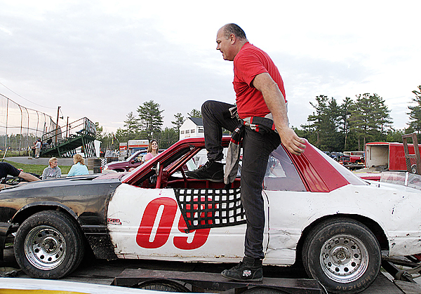 Keith Ogden uncoils himself from his Sport Four class racer at Speedway 95 after taking first place in the event Saturday, June 26, 2010. BANGOR DAILY NEWS PHOTO BY MICHAEL C. YORK