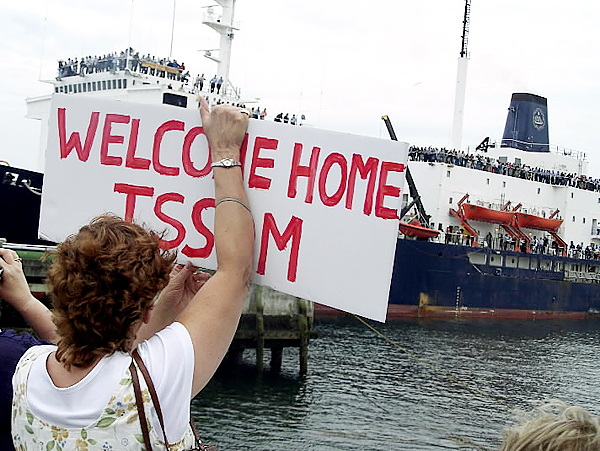 Kristi Birmingham of Lincoln holds a sign welcoming home her son, Jess Birmingham, who was one of 235 students to participate in the Maine Maritime Academy annual summer training cruise. The T/S State of Maine returned to Castine early Saturday evening after a 60 trip to Europe and back. BANGOR DAILY NEWS PHOTO BY  ERIC RUSSELL