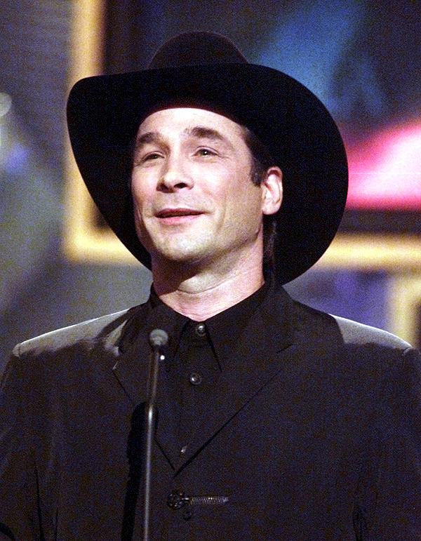 FILE--Clint Black is shown in this Sept. 22, 1999, file photo, at the Country Music Association Awards show in Nashville, Tenn. It was hard for Black to get his wife, Lisa Hartman Black, to sing her first duet with him because she's focused her career more on acting than singing. But now she's recorded with him again, which he said was much easier.  (AP Photo/Michael S. Green, File)