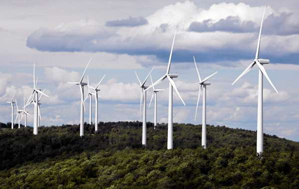 A cluster of windmills catches the wind blowing on Stetson Mountain in Township 3 Range 8 in July, 2009. (AP Photo/Robert F. Bukaty)