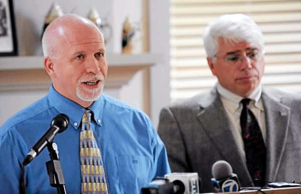 (BANGOR DAILY NEWS PHOTO BY KEVIN BENNETT)  CAPTION  University of Maine's Associate Director of System Operations John Grover, left, takes questions from the media on Tuesday, June 29, 2010 concerning the March 4, 2010 computer breach at the Orono campus. With John Grover is University of Maine's Vice President of Student Affairs Robert Dana. (Bangor Daily News/Kevin Bennett)
