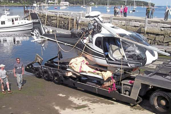 The helicopter that crashed into the water off Little Deer Isle on Saturday sits on a Belfast Boat Yard tractor-trailer Monday. The helicopter, which was based on the 185-toot luxury yacht Lady Christine, will be taken to the Belfast Airport, where it will be examined by federal investigators. (BANGOR DAILY NEWS PHOTO BY WALTER GRIFFI)