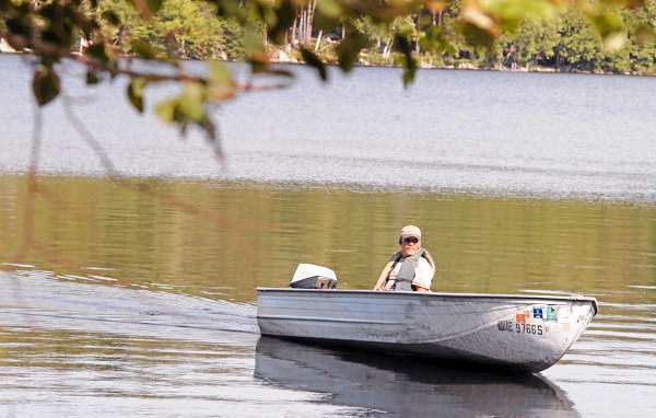 Lincoln Code Enforcement Officer Jerry Davis inspects shoreline properties on Long Pond in Lincoln on Thursday. (BANGOR DAILY NEWS PHOTO BY NICK SAMBIDES JR.)