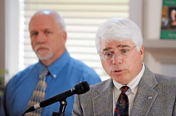 (BANGOR DAILY NEWS PHOTO BY KEVIN BENNETT)  CAPTION  The University of Maine's Vice President of Student Affairs Robert Dana, right, reads from a prepared statement on Tuesday, June29, 2010 concerning the March 4, 2010 computer breach at the Orono campus. With Robert Dana is the University of Maine's Associate Director of System Operations John Grover. (Bangor Daily News/Kevin Bennett)