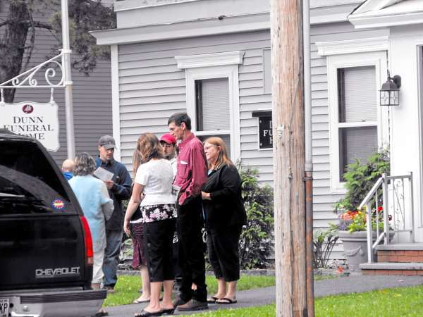 HOULTON: Mourners gather outside Dunn Funeral Home in Houlton after funeral services for Jesse Ryan, 10. Ryan, his father, Jeffrey Ryan, 55, and the elder Ryan?s close friend, 30-year-old Jason Dehahn of Amity, were found stabbed to death inside Jeffrey Ryan?s U.S. Route 1 mobile home in Amity last Wednesday evening. Cars lined both side of the street for Ryan's more than hour long funeral, which was attended by about 60 people. BANGOR DAILY NEWS PHOTO BY JEN LYNDS