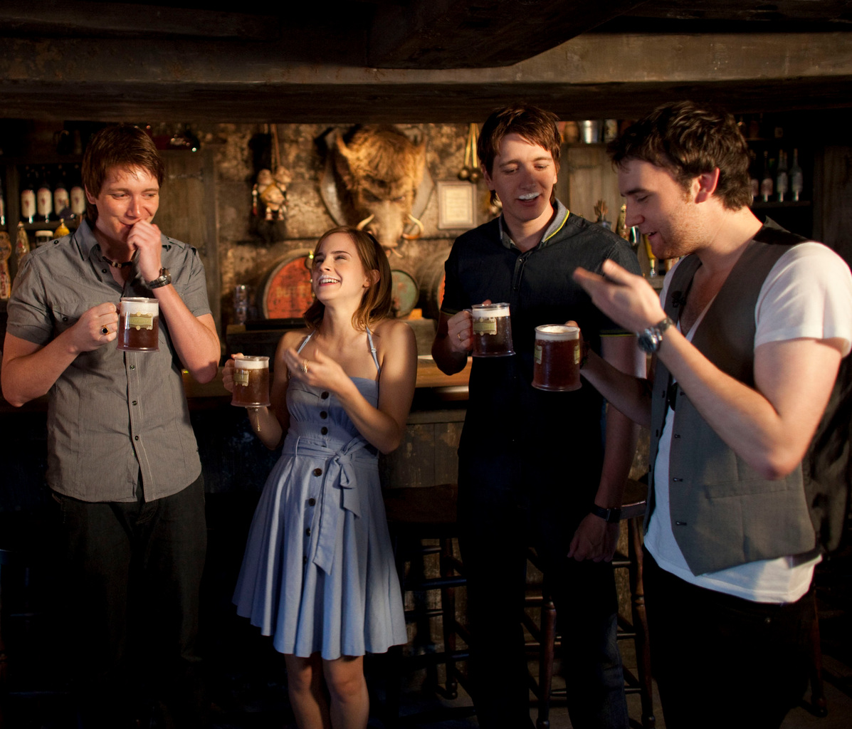 This photo provided by Universal Studios shows stars James Phelps, left, Emma Watson, second from left, Oliver Phelps, second from right, and Matthew Lewis as they taste Butterbeer during a preview of The Wizarding World of Harry Potter theme park at Universal Orlando Resort in Orlando, Fla., Thursday, May 20, 2010.   (AP Photo/Universal Studios, Kevin Kolczynski)  NO SALES