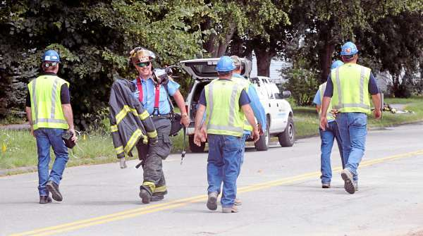 Bangor Fire Captain John Prentiss heads back to the firetruck as workers walk to their equipment after a gas leak was reported near a construction project on the Mount Hope Avenue near Maple Street in Bangor Thursday, July 1, 2010. (Bangor Daily News/Gabor Degre)