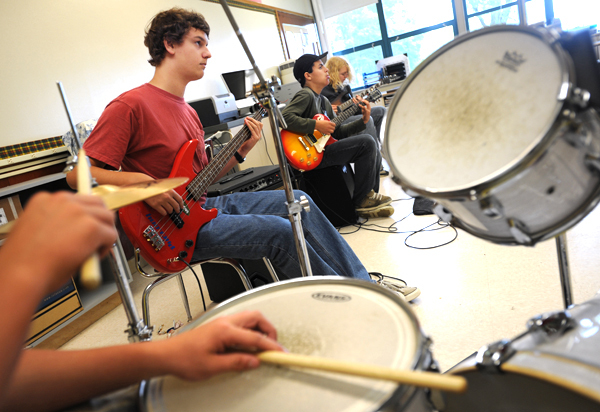 (L ot R) Brandon Archer, foregound, on drums, Nicholas Leach, on bass guitar and Anthony Branca and Casey Keenan play electric guitar during the first day of Rock Camp held at the Connors-Emerson school in Bar Harbor on Monday, June 28, 2010.