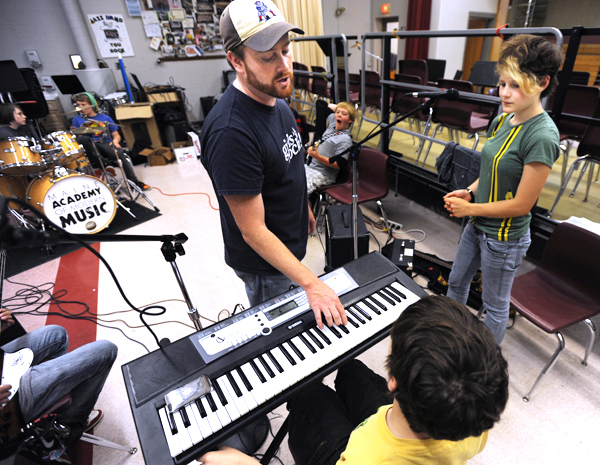 Jeff Shaw, center, executive director of The Maine Academy of Modern Music uses Nathan Von Der Harr's keyboard to help Lia Douillet, right, to grasp how her part is to be sung during the first day of Rock Camp at the Connors-Emerson school in Bar Harbor on Monday, June 30, 2010. (Bangor Daily News/Kevin Bennett)