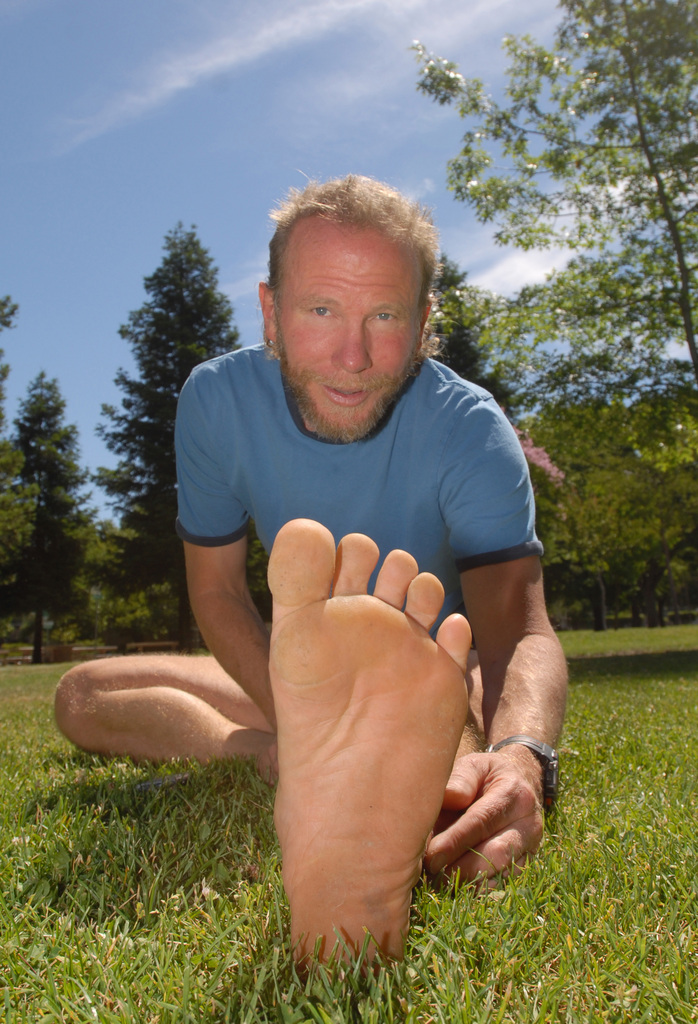 Michae Legault stretches after a barefoot run in Concord, California, on June 17, 2010. Advocates of running barefoot say it promotes a style of running that causes less stress on the body than even heavily padded running shoes because of the way the foot hits the ground. (Sherry Lavars/Contra Costa Times/MCT)