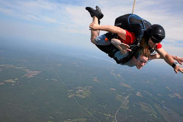 Bangor Daily News reporter Khela Kupiec (bottom) and instructor Matt Riendeau of Central Maine Skydiving take a 10,100 foot tandem plunge back Pittsfield Municipal Airport shortly after taking off from there Friday, June 18, 2010. (photo: courtesy of Steve Straub)