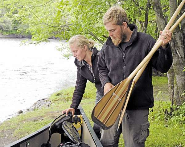 Originating in Old Forge, New York, the Northern Forest Canoe Trail ends in Fort Kent at the confluence of the St. John and Fish Rivers. Last week Whitny and Brian Hart completed the 740-mile trip. This was the first time either one of them had ever canoed. &quotIt was a lot of teamwork,&quot Brian Hart said. The couple plans to sell their 17-foot canoe locally before retuning to their home in St. George, Utah. (Photo by Julia Bayly)