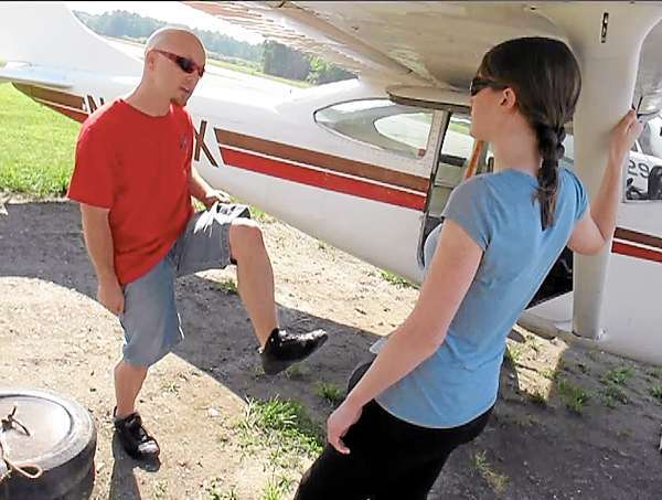 Matt Riendeau, left, of Central Maine Skydiving shows Bangor Daily News reporter Khela Kupiec proper descent posture before they boarded this Cessna for a 10,100 foot tandem parachute plunge back Pittsfield Municipal Airport Friday, June 18, 2010. (photo: courtesy of Steve Straub)