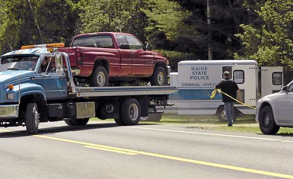 A truck registered to Robert and Joy Strout is removed from their residence at on U.S. Route 1 in Orient as Maine State Police Evidence Response Team members collect evidence Friday, July 2, 2010 in connection with last week's triple homicide. (Bangor Daily News/Bridget Brown)