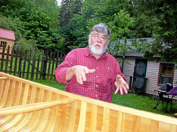 Bill Shamel of Grand Lake Stream displays the 20-foot Grand Laker canoe that he is raffling off to benefit the 16th Annual Grand Lake Stream Fok Art Festival. Photographed at his home Monday, June 28, 2010 in Grand Lake Stream. ( Bangor Daily News/John Holyoke)