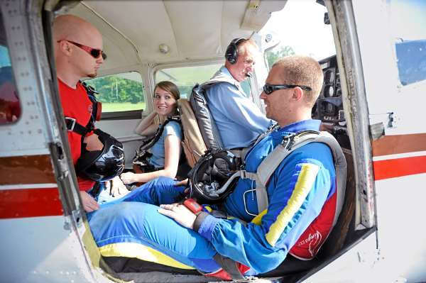 Left to right: Central Maine Skydiving instructor Matt Riendeau of Bucksport, Bangor Daily News reporter Khela Kupiec and Central Maine Skydiving videographer Steve Straub of Hudson prepare for take-off in a Cessna piloted by Bob Hart of Canaan at Pittsfield Municipal Airport Friday morning, June 18, 2010. (Bangor Daily News/John Clarke Russ)